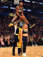 Indiana Pacers forward Glenn Robinson III leaps over