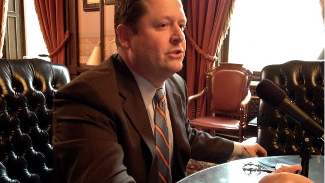 Michigan House Speaker Jase Bolger, R-Marshall, talks with reporters in his Capitol office on Wednesday in Lansing.