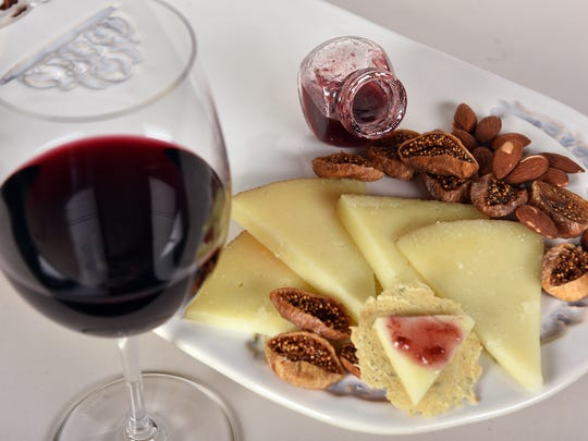 """Pairing suggestions can follow a guideline of """"what grows together goes together, so here we put together Murray's Young Manchego, a Spanish cheese made from sheep's milk, with roasted almonds and dried figs, a tasty Spanish red wine and some homemade fig rosemary and red wine jam."""