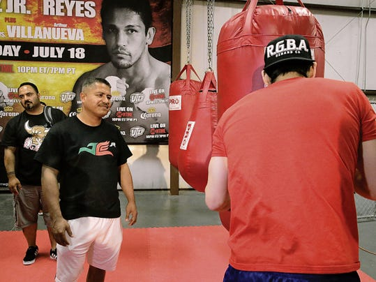 Robert Garcia, head trainer for Julio Cesar Chavez Jr., watches his fighter as he went through final preparations for his Saturday night fight against Marcos Reyes.