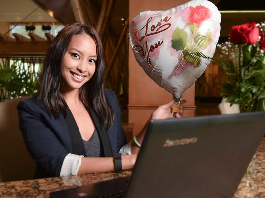 Show off that new relationship status to coworkers with a simple bouquet of roses and a matching balloon for her desk. Model: Katrina Untalan at the Outrigger Guam Resort on Jan. 12.