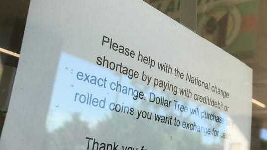 The Dollar Tree store in Hazel Park posts a sign at the front door on July 20, 2020, telling customers that the store will purchase any rolled coins that they want to exchange for cash. Shoppers are asked to pay by credit or debit card or exact change when possible.