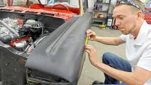 Jeff Smith works on a car for a previous 2015 News Journal story.