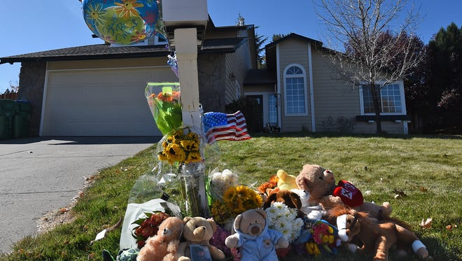 Stuffed animals, flowers and balloons have been placed around the mailbox of the home where Rob Deane fatally shot his two children, Austin, 2, and Jacob, 7, and himself.