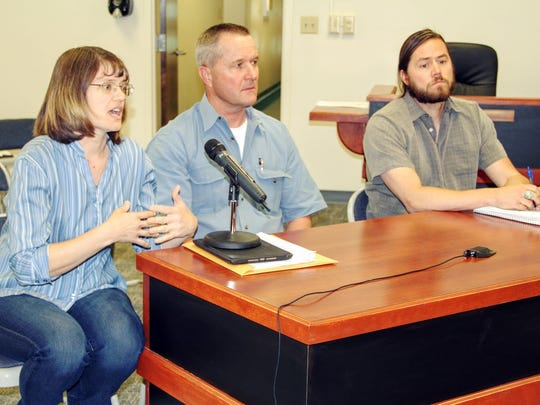 Vicky Milne of the Otero Soil and Water Conservation District , New Mexico State University's Otero County Cooperative Extension Office Agriculture Agent Sid Gordon and PLUAC member Kevin Lockhart discuss the African rue weed at the regular county commission meeting last Thursday.