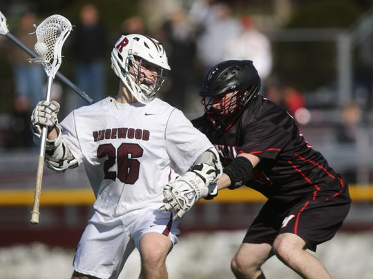 Jack Kiernan of Ridgewood tries to move around Garret Rofheart of Northern Highlands. Ridgewood went on to beat visiting Northern Highlands, 10-6,   Wednesday, March 29, 2017
