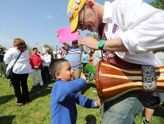 Steve Ramshur of Weehawken allows a younger attendee