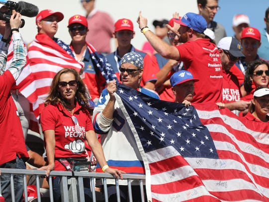 Fans of the United States squad show their colors at the first tee of the Presidents Cup, at Liberty National Golf Club in Jersey City on Thursday, Sept. 28, 2017.