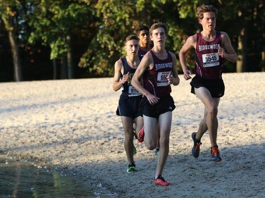 William Baginski (5545), of Ridgewood, is shown making a move on the sand, near the half way mark, to take the lead in Mahwah, Tuesday, October 10, 2017.