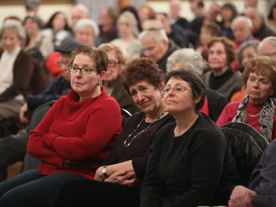 """About 150 people, including, Elaine Cohen, of Teaneck (front row, center), attend the """"Four Seasons Lodge"""" screening as well as a question-and-answer session at Congregation Beth Sholom in Teaneck on Sunday evening. The documentary film, by Andrew Jacobs, focuses on a group of Holocaust survivors, who vacationed in the Catskills in the 1990s."""