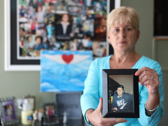 Donna Andelora, of Wayne, holds a portrait of her son, Joey, who died of an opioid overdose in 2012. She will be among several guest speakers at a forum on drug trends at Wayne Hills High School on Tuesday.