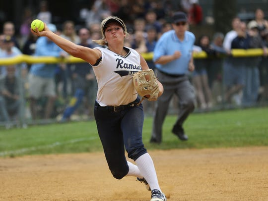 Kaitlin Houser, of Ramsey, throws to first for an Indian