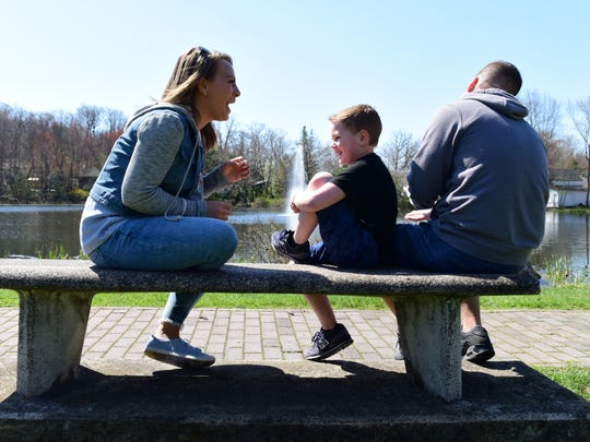 From left, Amanda Zita, 28, shares a laugh as her son, Mason, 5, tells a joke with her fiancé, Kevin Garrett in Bloomingdale.