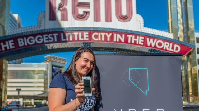 An Uber user poses with the app after the ridesharing service launched in Reno.