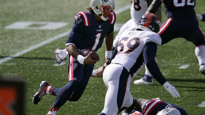 New England Patriots quarterback Cam Newton (1) runs for yardage against the Denver Broncos in the first half of an NFL football game, Sunday, Oct. 18, 2020, in Foxborough, Mass.
