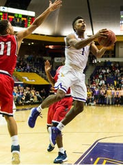 Lipscomb's Greg Jones goes up for a shot over the outstretched