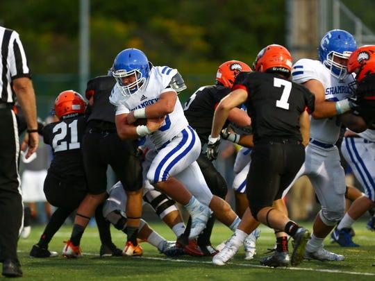 Junior fullback Cameron Ryan barrels into the end zone