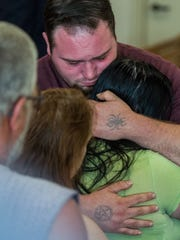 The parents of 2-year-old Aiden Haskins, father Noah Haskins and mother Ashley Stewart, hug after Joshua Blow was sentenced Wednesday.