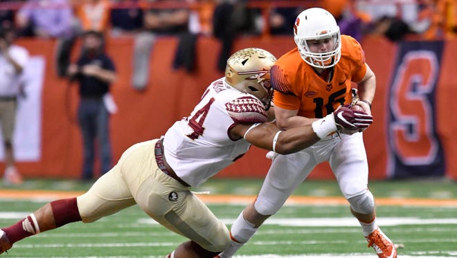 Nov 19, 2016; Syracuse, NY, USA; Syracuse Orange quarterback Zack Mahoney (16) is sacked by Florida State Seminoles defensive end DeMarcus Walker (44) during the first quarter of a game at the Carrier Dome.