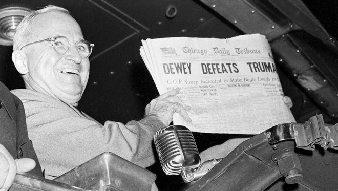 "U.S. President Harry S. Truman holds up an edition of the Chicago Daily Tribune, which, based on early results, mistakenly announced ""Dewey Defeats Truman"" on November 4, 1948. Thomas E. Dewey was born in Owosso."