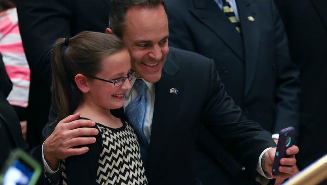 Gov. Matt Bevin, right, takes a selfie with Riley Caldwell, 10, during the Inaugural Welcome Party in the Grand Hall of the Center for Kentucky History in Frankfort. Dec. 8, 2015