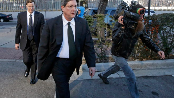 In this Jan. 21, 2015, file photo, brothers of polygamous sect leader Warren Jeffs, Lyle, foreground, and Nephi, leave the federal courthouse in Salt Lake City. Federal labor lawyers say a company regularly used children from a polygamous group as unpaid workers on a southern Utah pecan farm, refuting the company's contention that the kids picked up leftover nuts with their families.