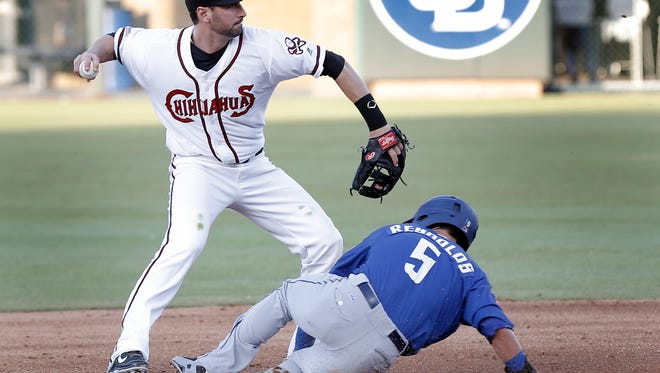 Chihuahua shortstop Nick Noonan completes a double play as Matt Reynolds of Las Vegas slides into second base Thursday at Southwest University Park.