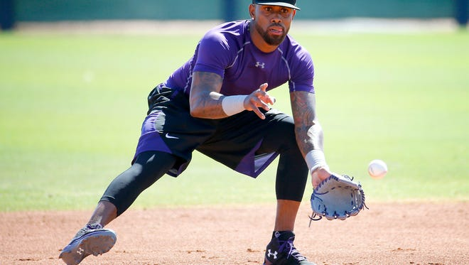 Colorado Rockies' Jose Reyes runs drills during an extended spring training, Thursday, May 19, 2016, at the Rockies' facility in Scottsdale, Ariz. Reyes was working out for the first time after being suspended under MLB domestic-violence policy.