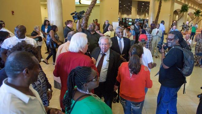 VictoryLand owner Milton McGregor, center, greets visitors as VictoryLand re-opens in Shorter, Ala., on Tuesday September 13, 2016.