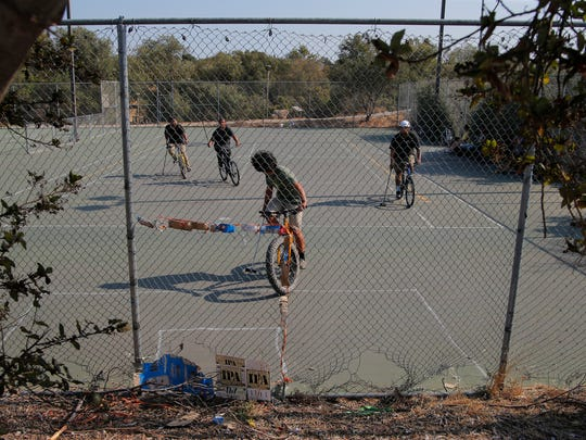 A group of cyclist play bike polo Wednesday at Natividad Creek Park in Salinas.
