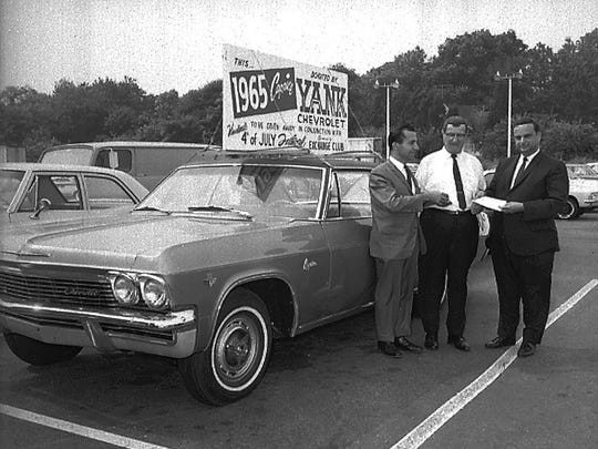 The keys to a new Chevy Caprice are handed over at Yank Chevrolet in 1965. The car, a contest prize, was awarded as part of Vineland's Fourth of July celebration at Landis Park that year.