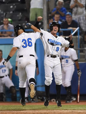 From left, Nathaniel Lowe and Miles Mastobuoni celebrate a two-run home run in the sixth inning of Thursday's playoff over the Lowell Spinners at Dutchess Stadium in Fishkill