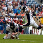 Denver Broncos kicker Matt Prater (5) kicks an extra point against the Houston Texans at Reliant Stadium in December.