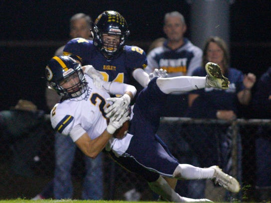 DeWitt's Derek Hamp (2) intercepts a pass intended
