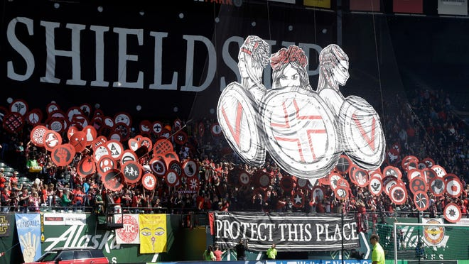 Portland Thorns fans display a large sign and shields before an NWSL soccer match against the Orlando Pride in Portland, Ore., Saturday, April 15, 2017. (AP Photo/Don Ryan)