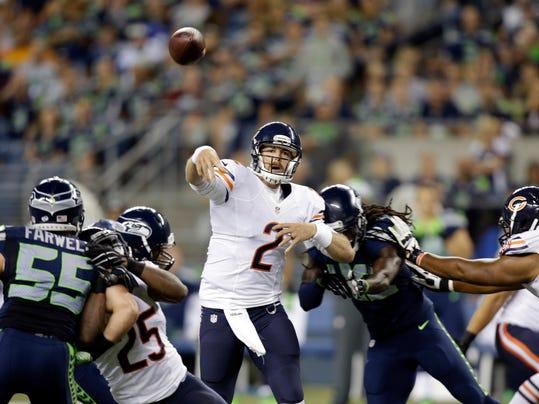 Chicago Bears quarterback Jordan Palmer (2) throws against the Seattle Seahawks in the second half of an preseason NFL football game, Friday, Aug. 22, 2014, in Seattle. (AP Photo/Stephen Brashear)