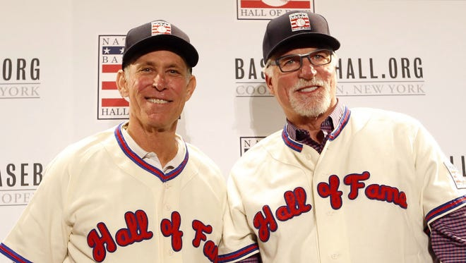 Hall of Fame inductees Alan Trammell, left, and Jack Morris try on their jerseys during the Baseball Hall of fame news conference at Walt Disney World Swan and Dolphin Resort in December.  Kim Klement/USA TODAY Sports Dec 11, 2017; Orlando, FL, USA; Hall of Fame inductees Alan Trammell (left) and Jack Morris try on their jerseys during the Baseball Hall of fame press conference at Walt Disney World Swan and Dolphin Resort. Mandatory Credit: Kim Klement-USA TODAY Sports ORG XMIT: USATSI-377188 [Via MerlinFTP Drop]