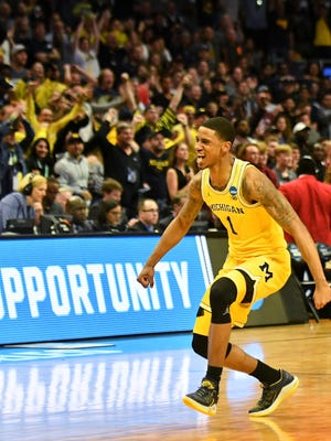 Michigan guard Charles Matthews reacts in the second half.