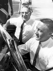 Gus Grissom takes his father for a spin, location unknown but possibly in Mitchell, Ind., Grissom's hometown. June 10, 1962