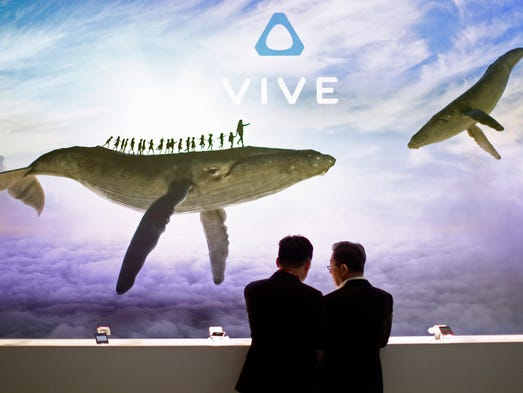 Visitor check devices in the Vive HTC booth during