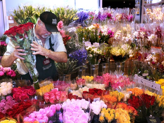 Flowers, a popular gift for moms, are prepared for Mother's Day at Whole Foods several years ago. As we come to another milestone in the COVID-19 journey, Mother's Day amidst physical distancing, it is important to consider how we might honor mothers