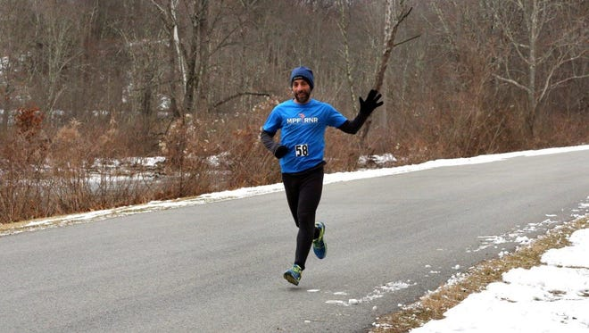 Jason Friedman, of New Paltz, runs the Recover from the Holidays race at Norrie Point on Saturday.