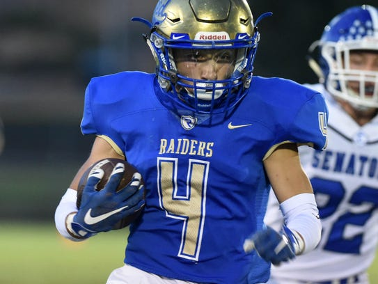 Reed's Isaac McCoy carries the ball against Carson
