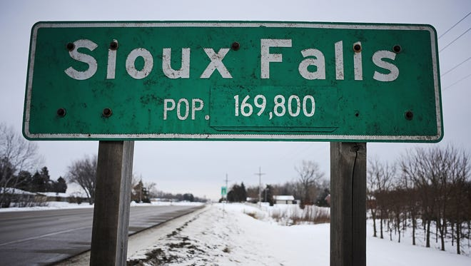 The Sioux Falls population sign is shown Tuesday near West 12th Street in western Sioux Falls. The 2015 population estimate is 173,000.