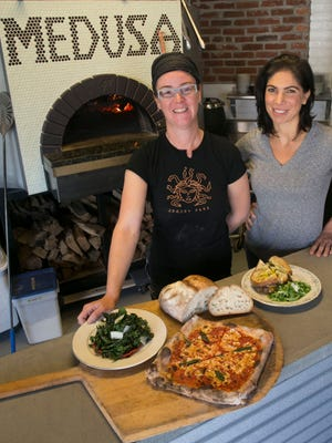 Aimee McElroy (left) and Lauren Castellini opened Medusa Stone Fired Kitchen in Asbury Park this summer.
