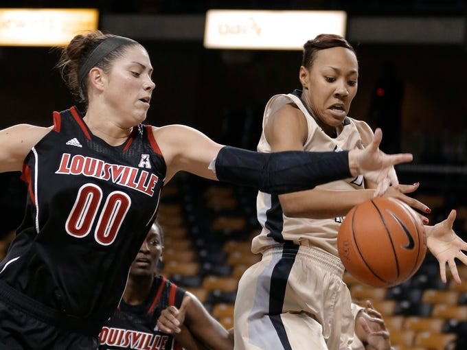 Louisville forward Sara Hammond (00) and Central Florida's Brittni Montgomery, right, go after a rebound during the first half of an NCAA college basketball game in Orlando, Fla., Tuesday, Feb. 4, 2014. (AP Photo/John Raoux)