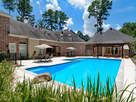 The yard has a pool, kitchen and pizza oven.