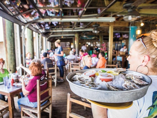 Diners are back in Port Aransas, enjoying the seafood at Virginia's on the Bay.