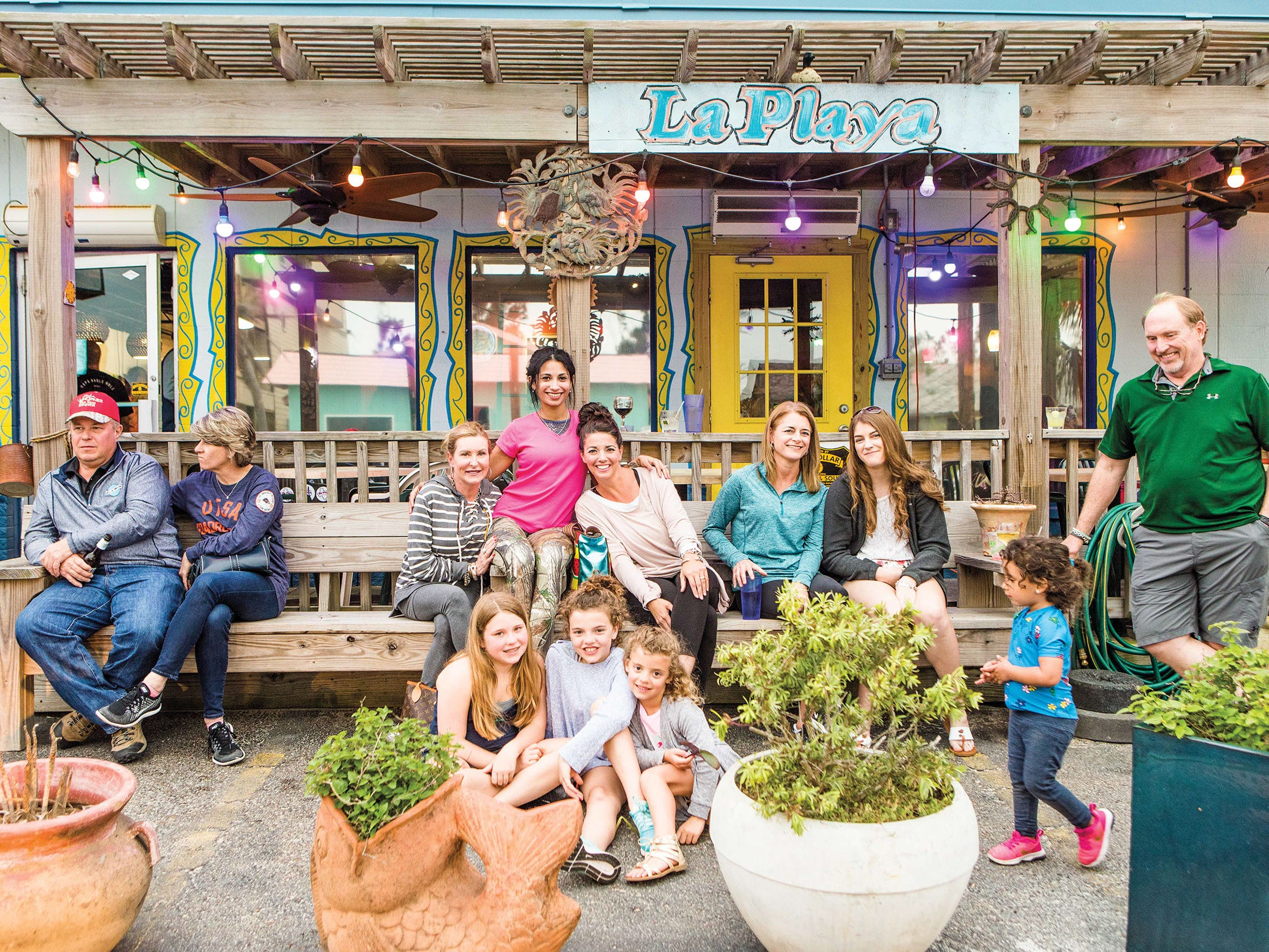 A family of diners poses for photos at La Playa Mexican