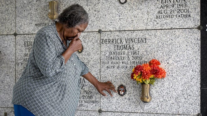 Edith Morgan, 71, mother of the late Kansas City Chiefs' Hall of Famer Derrick Thomas, gets emotional as she visits her son's memorial near Miami days before the 20th anniversary of his death and days before the Chiefs play in Super Bowl LIV in Miami.